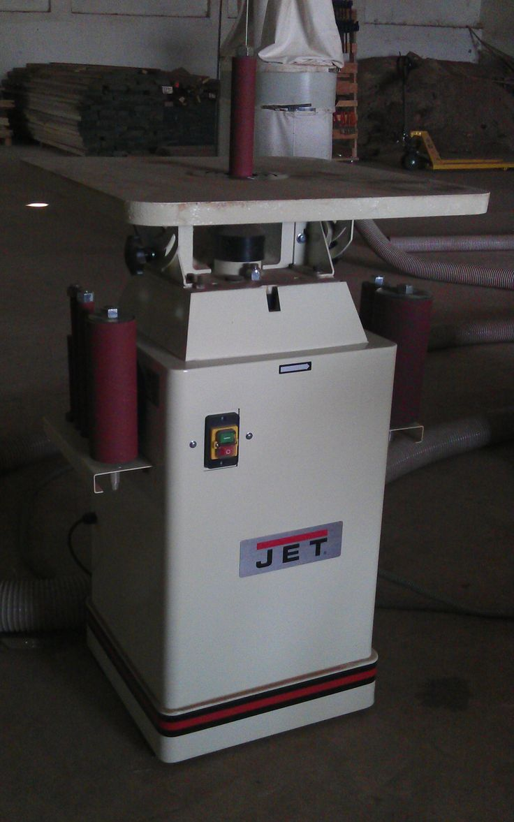 Oscillating spindle sander with tilting table.
