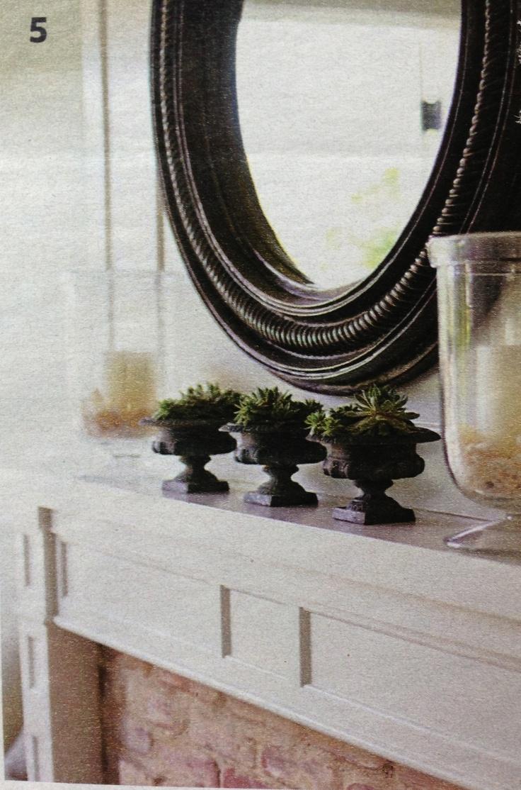 Round mirror above mantle.