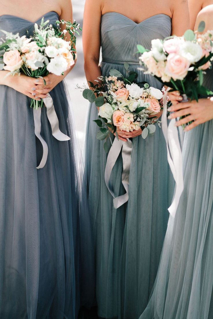 These bridesmaids look ethereal in smokey grey dresses.