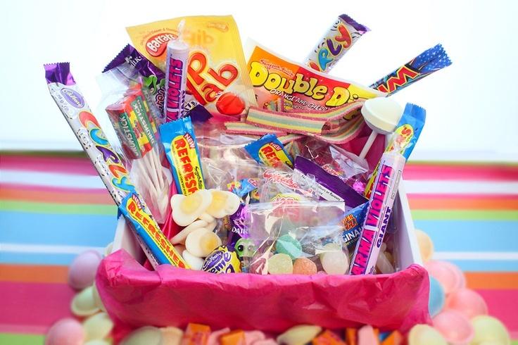 Each box contains: 1 bag Pear Drops/ 1 bag Rhubarb & Custard / 1 x Curly Wurly / 8 x Anglo Bubbly / 10 x Flying Saucers / 1 x Wham Bar /1 x Refresher / 1 x Dip Dab / 1 x Freddo Frog / 1 x Double Dip /2 x Bag Rainbow Drops / 2 x Chuppa Chupp Lollies / 1 x bag American Hard Gums / 1 x bag Shrimps / 5 x Drum Stick Lollys