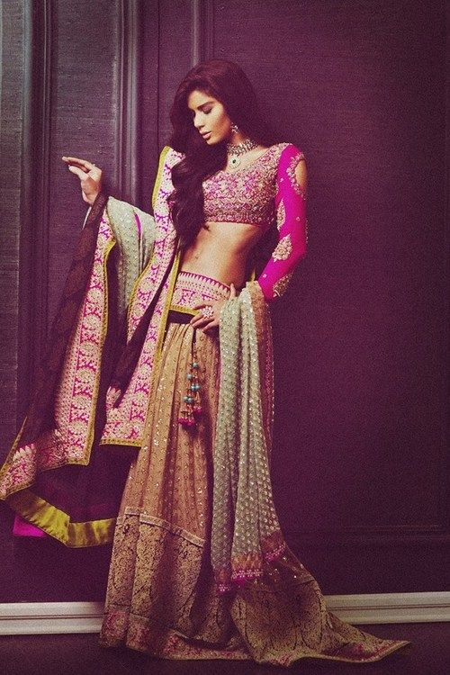 A stunning pink and gold wedding lehenga, perfect to wear at a Sangeet! #pink #gold #bride #wedding #lehenga #love #beautiful #royal found on www.thewedding-hut.co.uk Read more about Indian Wedding Attire on my blog - http://bigfatasianwedding.com!