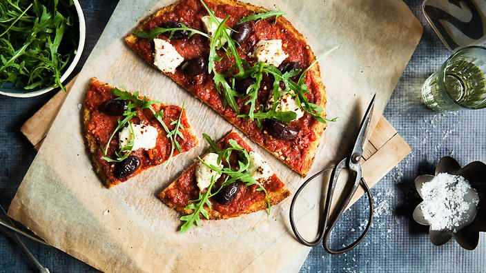 Get your cauliflower fix in this gluten-free pizza base. Topped wtih tomato, ricotta, chilli and olives, it's the kind of meal dreams are made of.