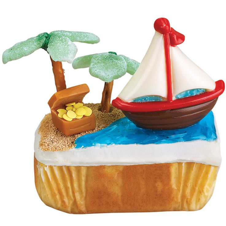 Once upon a time, a sailboat shaped in our Transportation Candy Mold sailed across a Mini Loaf Pan cake to a tropical isle where candy-leafed palms shade a caramel-candy chest filled with yellow-confetti doubloons. The end.