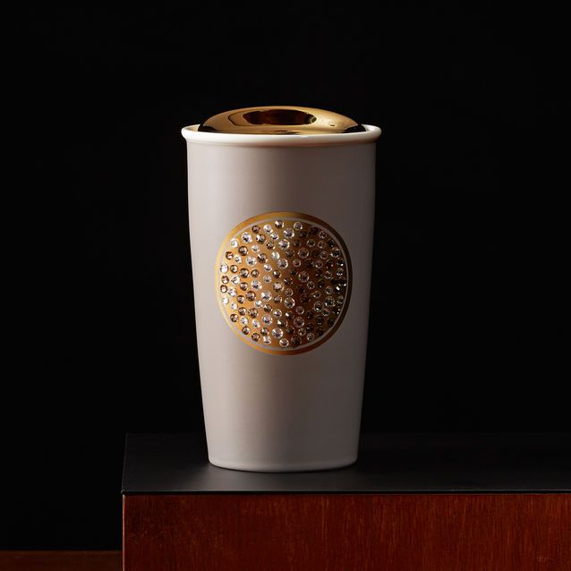 A limited edition travel mug embellished with Swarovski® crystals and gold accents. Packaged in a navy blue gift box.