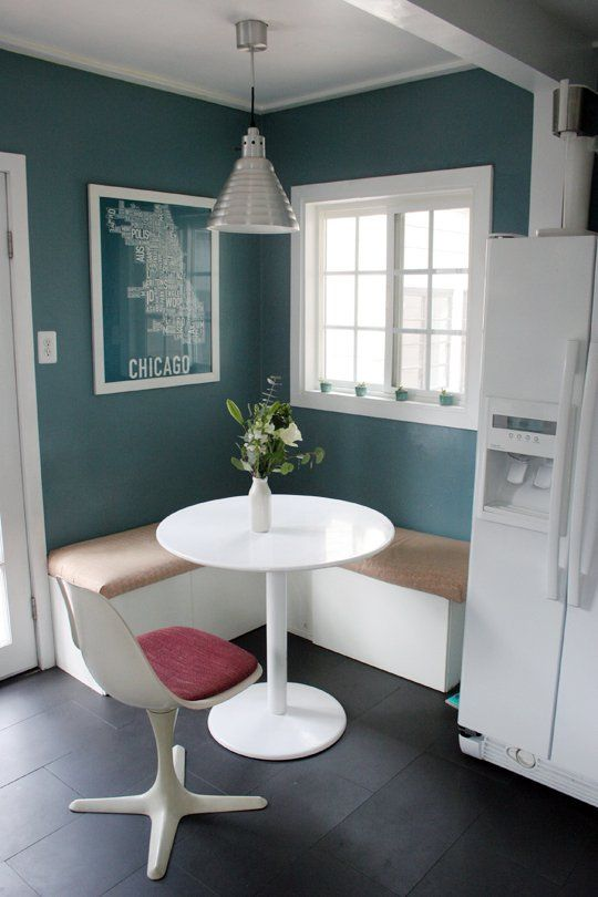 Molly&Tyler Apartment Therapy. Corner bench seating in the kitchen, love the wall colour too.