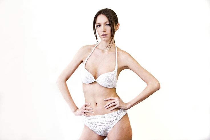 The N12 bikini is the world's first ready-to-wear, completely 3D-printed article of clothing. All of the pieces, closures included, are made directly by 3D printing and snap together without any sewing. Continuum Fashion. Photography: Ariel Efron