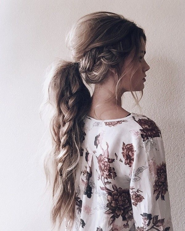 Voluminous hair with pony-tail and braid.