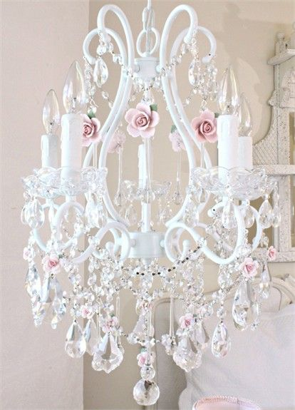 5 Light Crystal Chandelier with Pink Porcelain Roses....ISNT THIS BEAUTIFUL. I BOUGHT MY SISTER KAREN A WHITE SHABBY CHIC CHANDELIER VERY MUCH LIKE THIS WITHOUT THE ROSES,IT WASNT EXPENSIVE I BOUGHT IT LOWES OR HOME DEPOT. SHE DECORATED IT HERSELF WITH STRANDS OF PEARLS,PINK ROSES,AND PINK GEMED JEWELERY AND ITS EVEN PRETTIER THAN THIS CHANDELIER...CHERIE