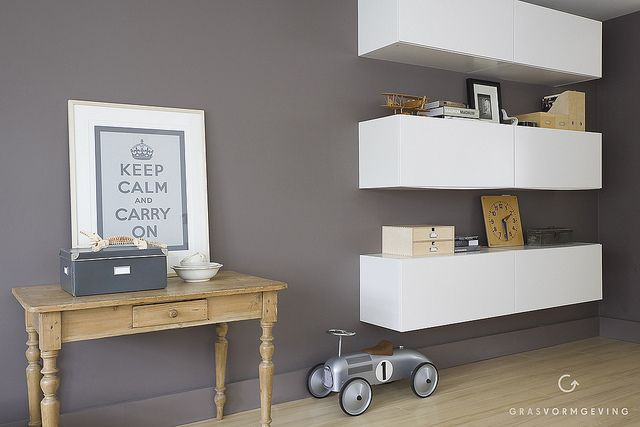 The kitchen cabinets of Ikea used as a storage and shelving system for the living room.