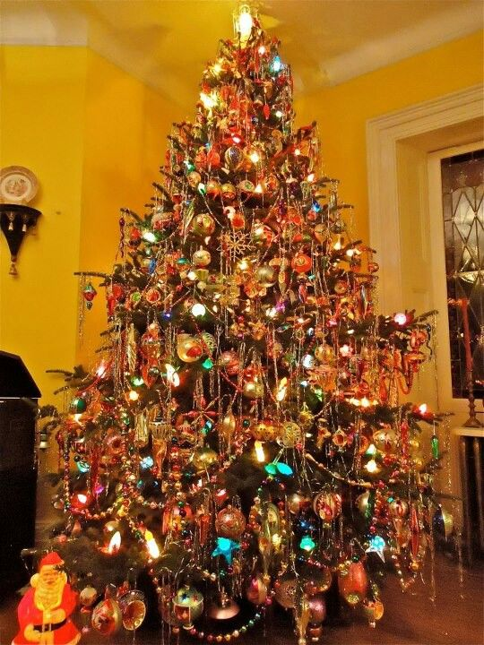 """A Christmas tree decorated  with """"Christopher Radko """" Ornaments.I own some of his early ornaments, when he first started his company in the early years,1985-the 1990s."""
