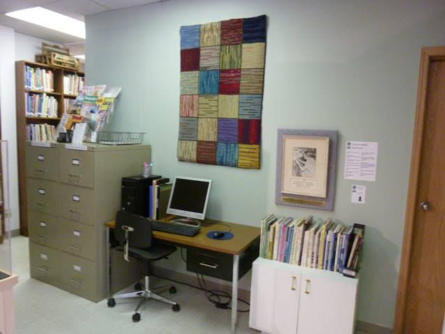 Renovated library area with new paint, signs and a recently acquired hooked rug by Nydia Peterson. Have you ever looked in the vertical file? There are tons of patterns, small booklets and other gems full of information.