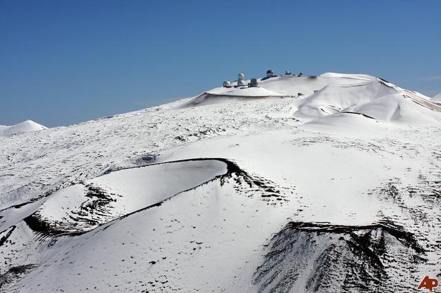 Snow on MaunaKea, Hawaii. Observatories at the top.