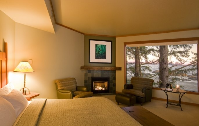 The bedroom of the Frank Island Suite, overlooking North Chesterman Beach, featuring gas fireplace and private balcony, as do all of our rooms.