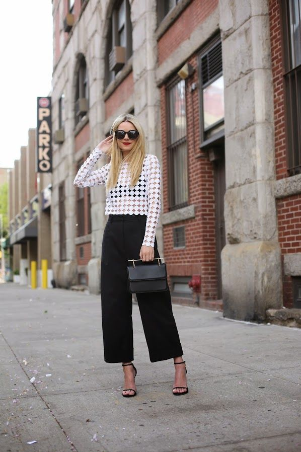 high waist wide leg cropped trousers with cut out crop top and high heels