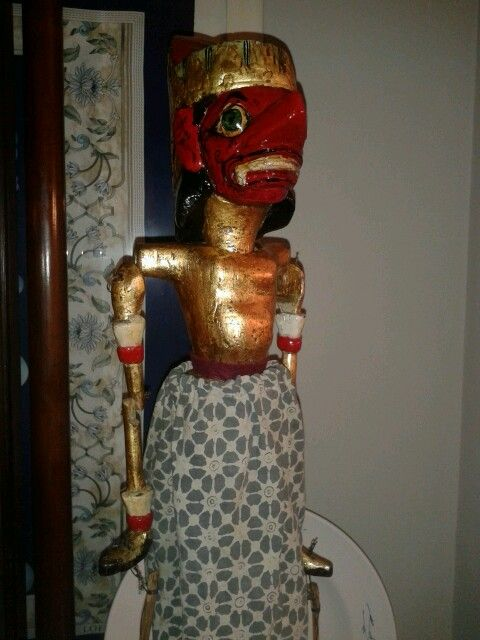 antique thai puppet made of wood and gilded