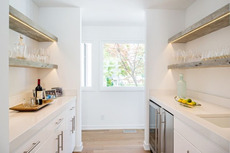 The butler's pantry provides a nook for wine, spirits, glassware and more.