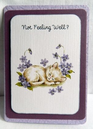 """The kitty picture is layered on a purple backing layer. Then layered on a lilac embossed card.  6"""" x 4.25""""  15 cm x 11cm"""