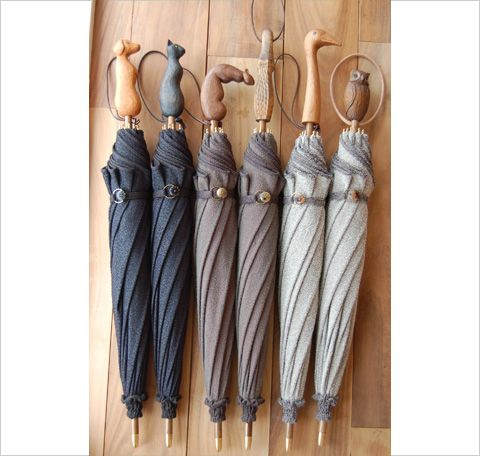 Wooden Umbrella Handles!!  This site has the most exquisite wooden crafts!