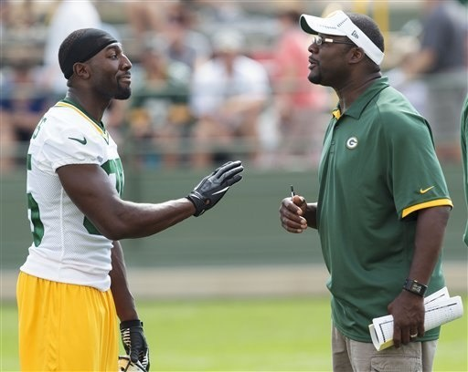 Image detail for -Green Bay Packers wide receiver Greg Jennings (85) talk with wide receivers coach Edgar Bennett during NFL football training camp Thursday, July. 26, 2012, in Green Bay, Wis. (AP Photo/Mike Roemer)