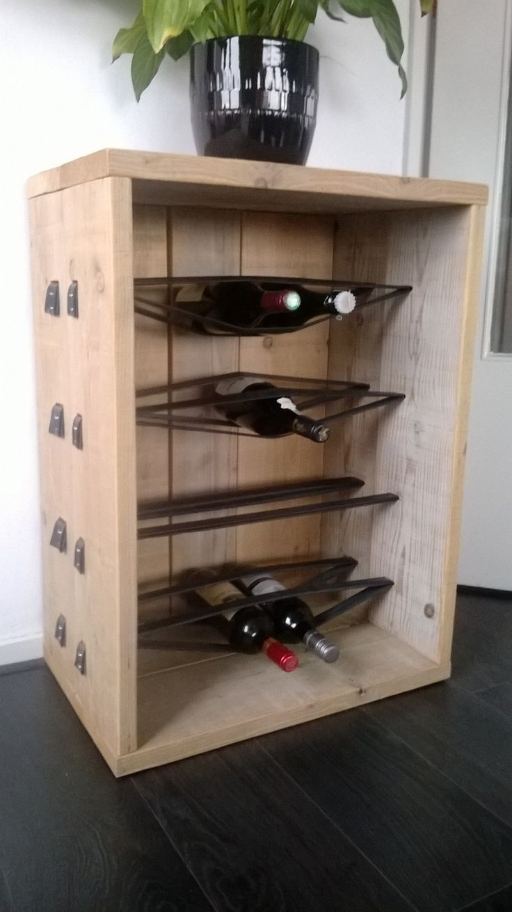 DIY wine rack from bicycle inner tubes and scaffolding boards