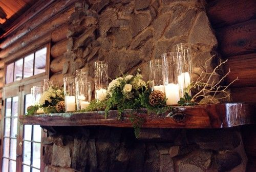 This fireplace mantel from a wedding coordinated by Bridal Bliss at Summit Grove Lodge is the perfect example of rustic elegance.
