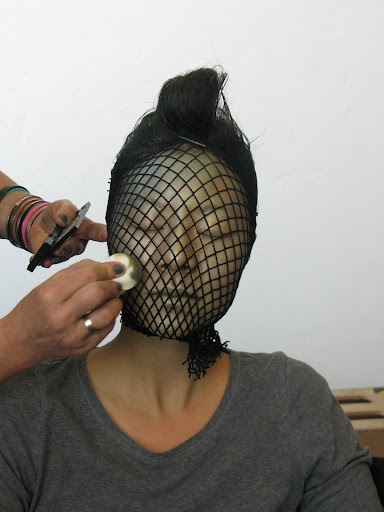 Fishnet stockings and green make-up to create scales for Halloween!