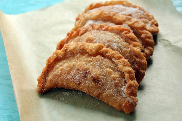 Empanadas de Viento, cheesy and airy fried dough, topped with granulated sugar.  Fanesca is accompanied by fried sweet plantains, sometimes avocados, and also masitas, which are essentially fried empanadas like these.