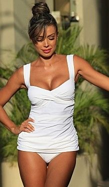 White Marilyn TankiniThe Ultimate Tankini! Gathered at the sides, this style is perfect for slimming your body and hiding any imperfections.  Classic twist top will fit your bust perfect and elastic halter strap gives you extra support. High waisted bottoms are just the right amount of coverage to feel sexy and secure. Tankinis http://www.tropicalbeachfashion.com
