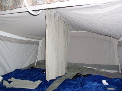 Pop up Camper Bunk Room Divider Curtain...would buy curtain or hem a sheet. Add weights to hem so that it hangs just above the mattress. Add small pockets for storing stuff towards the top....game systems, books, eyeglasses, etc. - rugged-life.com
