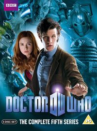 """A DVD boxset cover consisting of a man with black hair reaching forward over a logo which says """"Doctor Who"""". He is wearing a bowtie and tweed jacket. Looking out from behind him is young woman with red hair, wearing a red shirt and brown jacket. The background is blue and shows a masked reptilian humanoid, a statue with open jaws, the head of a robot, and a robot-like creature with an eyestalk."""