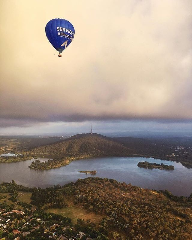 """Instagrammer @jayneytravels shared this epic shot of the nation's capital from the sky. """"I was so lucky to end the year on a (literal) high in a hot air balloon ride over Canberra."""" What did you tick off your bucket list last year? #visitcanberra #CBRbucketlist"""