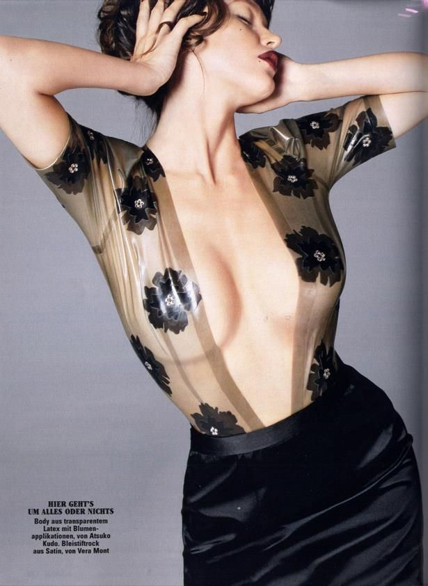 Pazde la Huerta wears black latex Atsuko Kudo semi-transparent cloud grey latex Jessica Body with 2D Applique Flowers for Glamor Magazine.