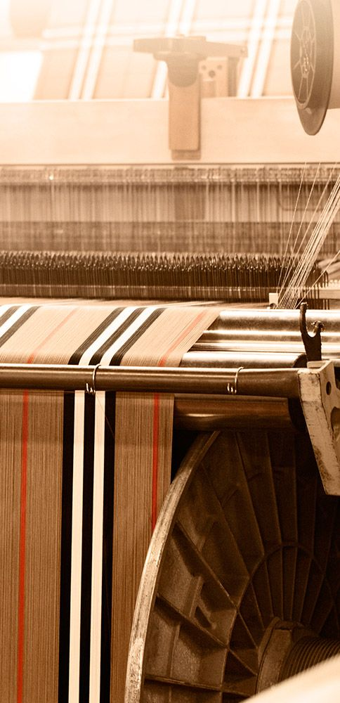 A Burberry icon – check cloth is woven on a loom at the Keighley mill in Yorkshire, England