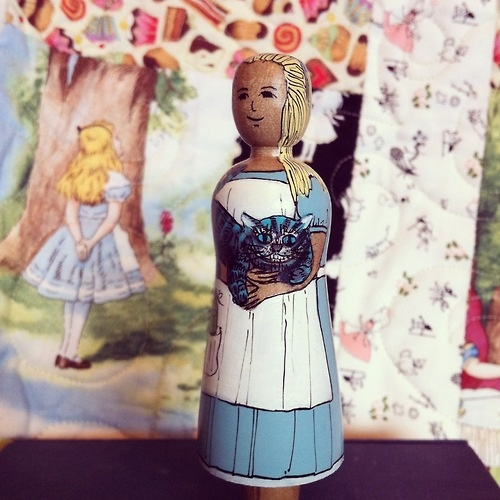 Alice in Wonderland, with Cheshire Cat, painted by Jilli Roberts for the Deepings Dolls.  (Alice quilt in the background made by me!)