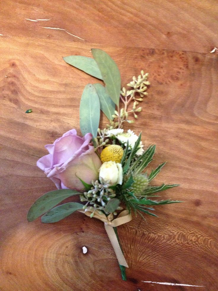 Lovely rose buttonhole I arranged for a friends wedding. By doing the flowers ourselves we got to give every guest a buttonhole in luxurious beautiful flowers for a snip of the cost. Good old YouTube!