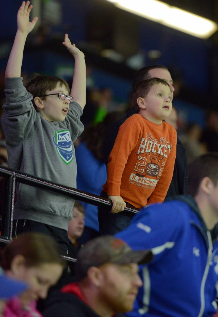 Tina Russell / Observer-Dispatch Utica Comets fans wave there hands in the air in an attempt to get free shirts in-between periods during AHL hockey at the Utica Memorial Auditorium Thursday, Jan. 1, 2015.  Read more: http://www.uticaod.com/apps/pbcs.dll/gallery?Site=NY&Date=20150101&Category=PHOTOGALLERY&ArtNo=101009998&Ref=PH&taxoid=&refresh=true#ixzz3NdcccdkO