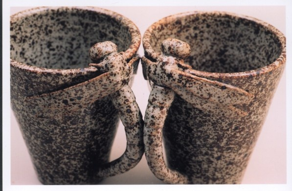 Wheel formed mugs with sculpted dragonfly handles, brown stoneware clay with clear glaze. By Tanya Bechara (circa 2004)