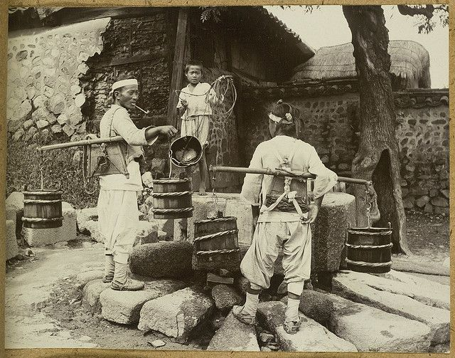 Water for commoners came mainly from communal wells, except for some 'yangban' households that had their own. Households without wells used water carriers balancing buckets on a shoulder-pole. Source: Pratt, Keith. Old Seoul, 1902. To supply a large city with water from neighborhood wells is a work of no small magnitude, and the water-carrier is a recognised institution, which boasts of a powerful guild. The work is genuine and hard, and the pay is correspondingly high.e Homer B. Hulbert.