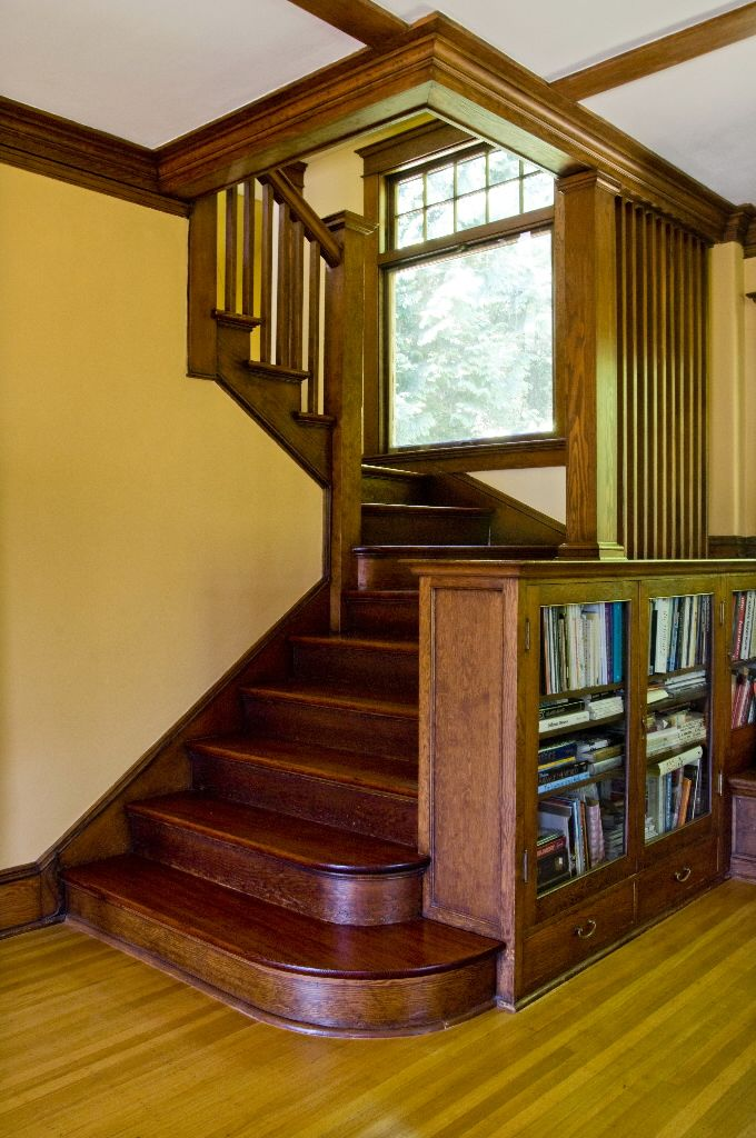 The reading bench and built-in bookcase adjoining the main staircase became a favorite spot for the original homeowner, Charles Malboeuf.