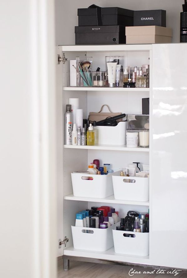 using Pax wardrobe and white bins to organize personal hair and body care products and tools