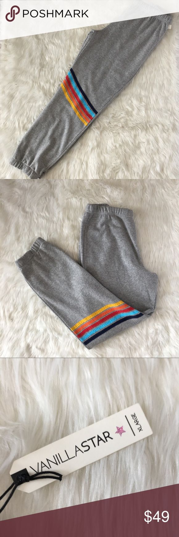 Retro Rainbow Stripe Joggers Sweatpants Vanilla Star Womens Gray Heather Retro Rainbow Stripe Joggers Sweatpants  Cotton polyester blend- Super soft ! Elastic waistband  Brand new with tags  Quick shipping! WE SHIP EITHER THE SAME BUSINESS DAY OR NEXT. ORDERS ON WEEKENDS ARE IN MAIL BY MONDAY MORNING. Vanilla Star Pants Track Pants & Joggers