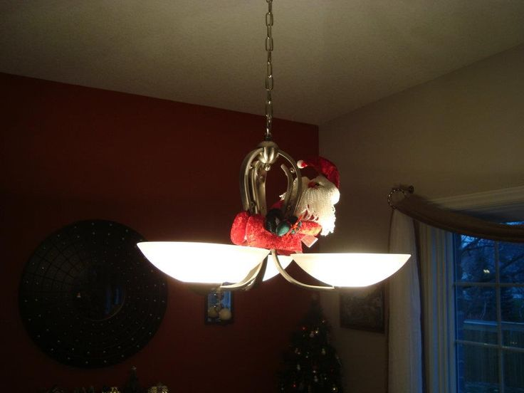 Santa hanging on a light