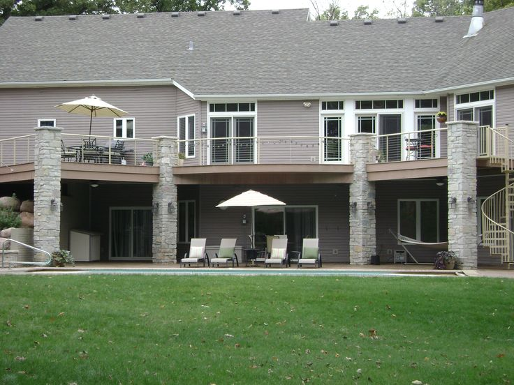 walk out basement with pool patio and deck above