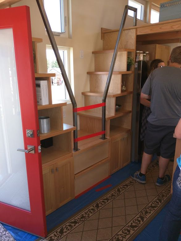 Double stair case with pull-out bottom steps. Sprout Tiny Home. Tiny House Jamboree 2016.