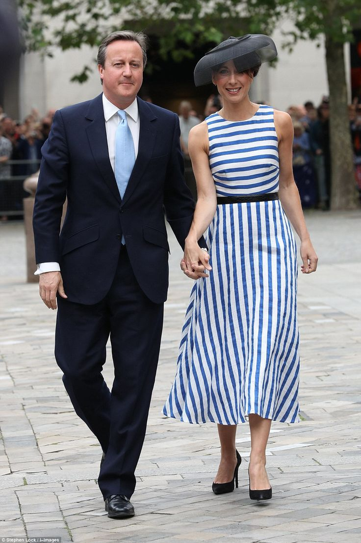 Samantha Cameron stunned in a simple striped midi dress and an elegant black hat as she arrived hand-in-hand with husband David