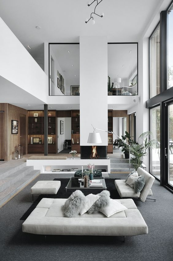 Scandinavian Living Room With A High Ceiling And Big Windows Grey