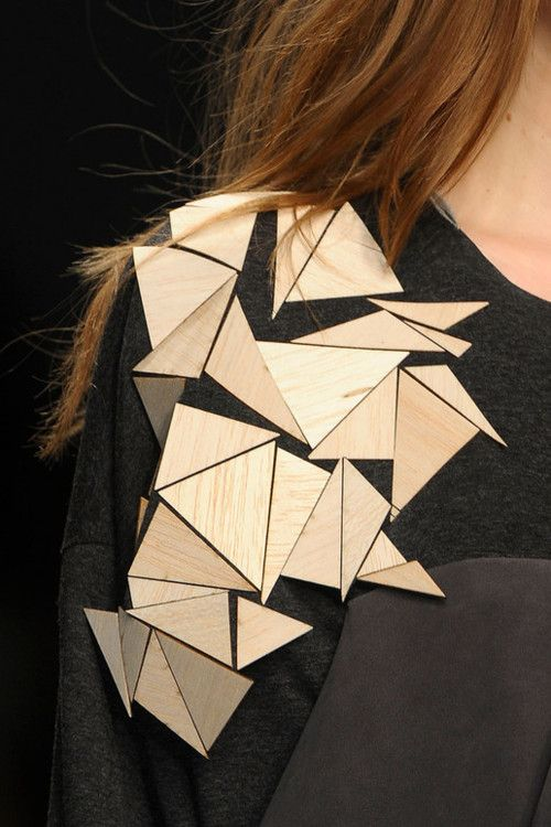 Geometric Fashion - dress shoulder embellished with wooden triangles - contrasting materials; juxtaposing fashion details