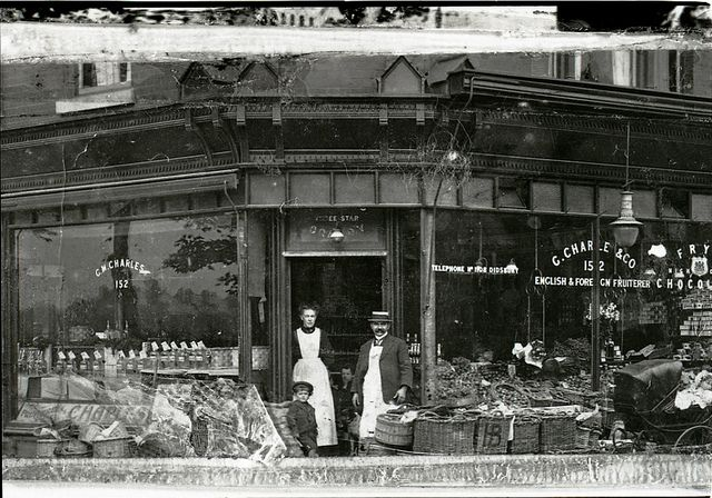 #Didsbury #Manchester  George Charles' second shop, on the corner of Nell Lane and Burton Road, c.1910 (GB124.DPA/1802/2)  George Charles' second shop, on the corner of Nell Lane and Burton Road. Telephone number: Didsbury 1108. Donor's father right; woman on left unknown; donor in centre aged 3 or 4. c.1910. The business moved to Lapwing Lane in the 1920s.  more: https://www.flickr.com/photos/manchesterarchiveplus/5211483864/in/set-72157628510542887
