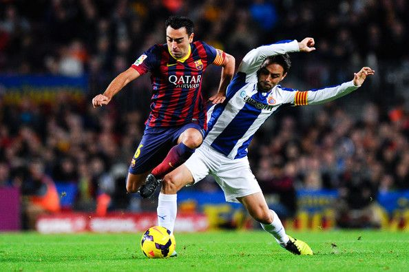 Xavi Hernandez of FC Barcelona duels for the ball with Sergio Garcia of RCD Espanyol during the La Liga match between FC Barcelona and RCD Espanyol at Camp Nou on November 1, 2013 in Barcelona, Catalonia.