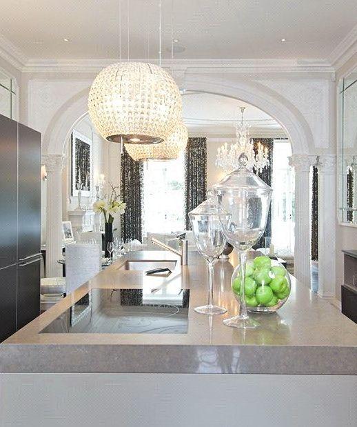 Glamorous white kitchen love the crystal chandelier for Glamorous kitchen ideas